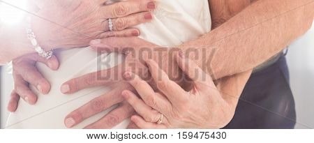 Older Couple Cuddling Together