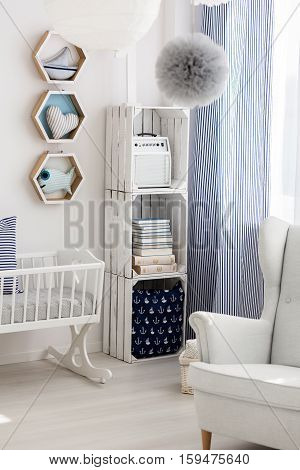 Neutral Nursery With Cradle And Chair