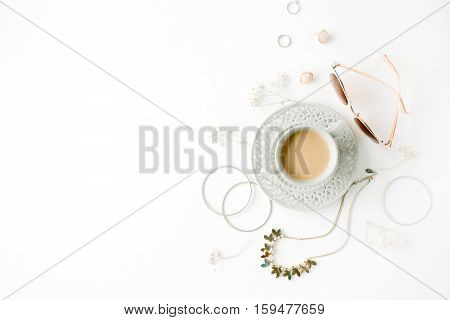 morning breakfast with cup of coffee with milk and trendy fashion accessories arrangement on white flat lay top view