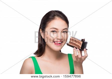 Beautiful smiling asian young woman with a chocolate cake isolated on white background.