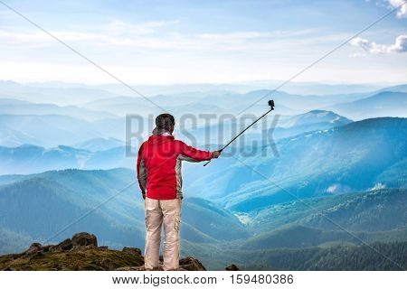 Young Man On The Top Of Mountain