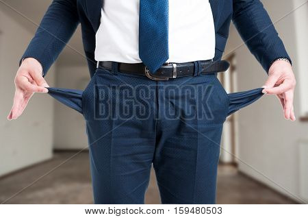 Closeup Of Male Realtor Showing His Empty Pockets