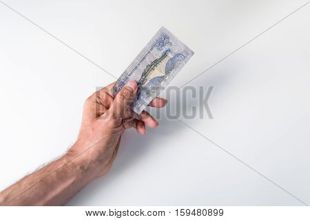Man Holding One Bhutanese Ngultrum Banknote In His Hand