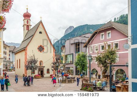 ORTISEI,ITALY - SEPTEMBER 16,2016 - Place with Church of Saint Antonius in Ortisei. Ortisei is a town in South Tyrol in northern Italy. It occupies the Val Gardena within the Dolomites a mountain chain that is part of the Alps.