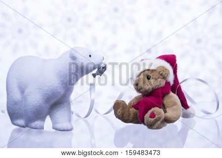 Polar Bear brought fish for brown bear. On New Year's background.