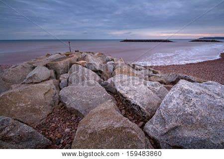 Seascape with breakwaters near the shore in the Sidmouth area of the city. Devon. England