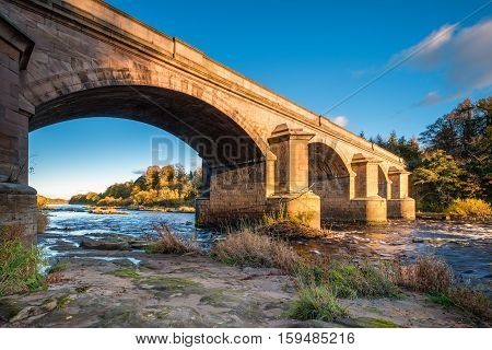 River Tyne flows under Bywell Bridge, through Northumberland, under the stone arched Bywell Road Bridge near Stocksfield