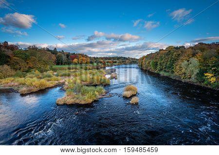 River Tyne below Corbridge, winding its way down the Tyne Valley below Corbridge in Northumberland, on a sunny day