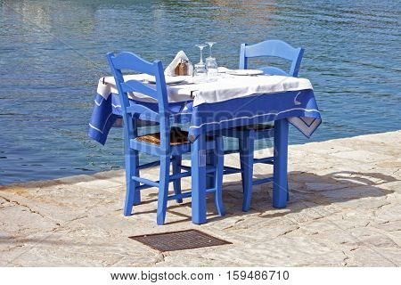 A table of traditional Greek tavern by the sea of fiskardo in Kefalonia
