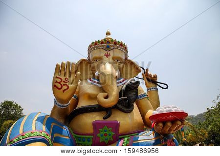 Kanchanaburi THAILAND - April 16, 2015 : Ganesha statue the Hindu god that whose head is an elephant head at Temple in Kanchanaburi Thailand. He is a god of knowledge and success.