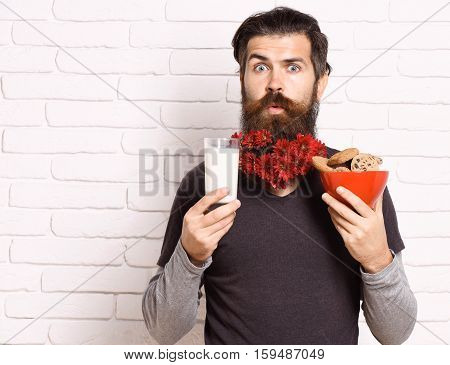Hipster With Flowers In Beard
