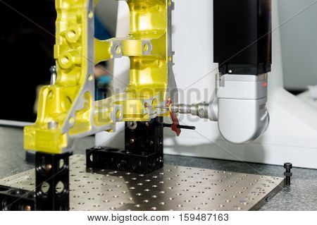 5-axis measurement operator inspection dimension aluminium automotive part after machining in industrial factory