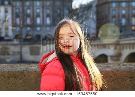 Portrait of little girl smiling in the city
