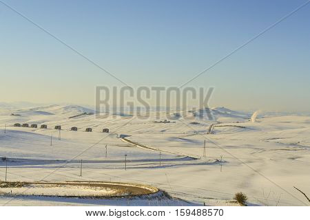 RURAL LANDSCAPE WINTER.Between Apulia and Basilicata. snowy hills landscape with abandoned farmhouses. -ITALY- .