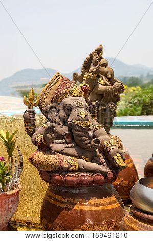 Kanchanaburi THAILAND - April 16, 2015 : Ganesha statue the Hindu god that whose head is an elephant head at Temple in Kanchanaburi Thailand. He is a god of knowledge and success.