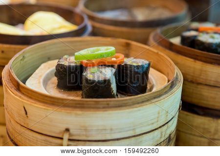Chinese steamed dumpling in bamboo basket in Chinese food restaurant at Shanghai China.