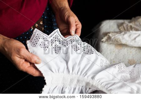 Close up shot of a traditional hand made shirt in Maramures Romania.