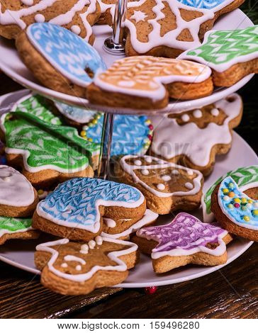 Close up of Christmas gingerbread cookies on Tiered Cookie Stand.