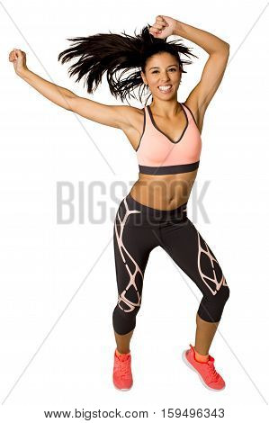 young beautiful latin woman in fitness clothes dancing in aerobic workout happy and excited isolated on white background in healthy lifestyle and gym dancer instructor concept