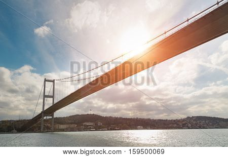 Iconic Istanbul view with the Bosphorus Bridge and sun flare during winter