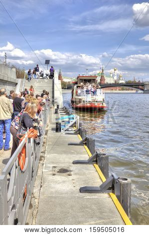 MOSCOW RUSSIA - May 02.2016 : People on moorage on Prechistenskaya of embankment in expectant of excursion steamship