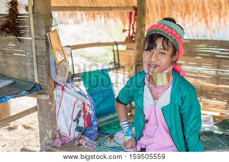 CHIANG RAI, THAILAND - FEBRUARY 4, 2016:  Karen long neck in a village between Chiang Rai and Chiang Mai. Karen is one of several ethnic hill tribes in northern Thailand