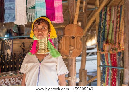 CHIANG RAI, THAILAND - FEBRUARY 4, 2016:  Karen long neck woman in a village between Chiang Rai and Chiang Mai. Karen is one of several ethnic hill tribes in northern Thailand