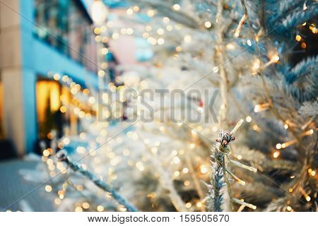 Christmas time in the city. lluminated christmas tree in the street Munich Germany - selective focus