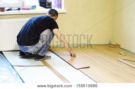 The Process Of Installing Laminate Wooden On The Floor
