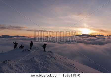 Winter inversion of clouds during the sunset viewed from the summit of the mountain