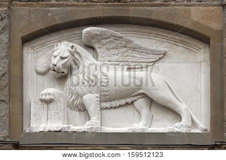 mascaron ornament on an ancient building and Venetian lion in Bergamo town