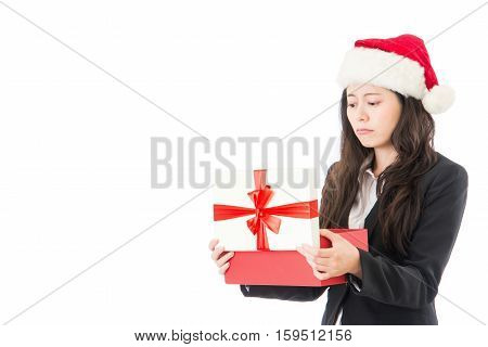 Woman Opening Christmas Gift Disappointed And Unhappy