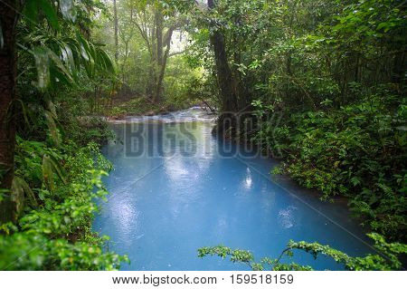 Rio celeste river at rainy day Tenorio national park Costa Rica