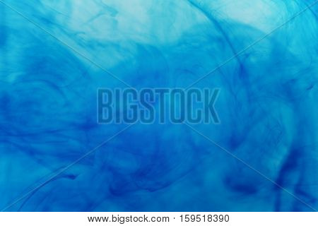 acrylic blue color in water, abstract background