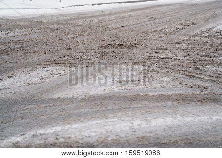 dirty snow on town intersection, crossroad slush