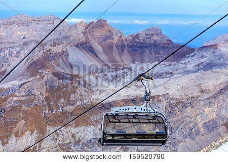 A seat of a chair lift in the Swiss Alps, shallow depth of field.