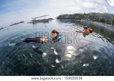 Free divers training in the calm bay