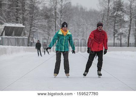 Saint-Petersburg Russia - December 2 2016: Urban outdoor ice rink in the park.