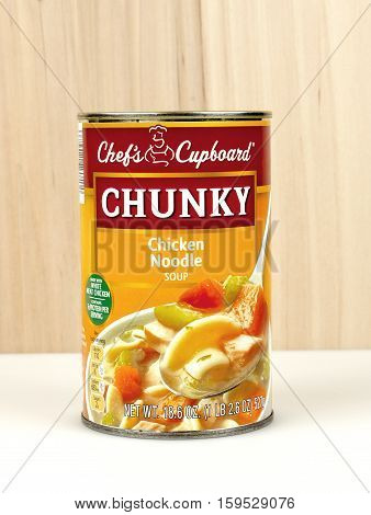 RIVER FALLS,WISCONSIN-DECEMBER 01,2016: A can of Chefs Cupboard brand chunky chicken noodle soup against a wood background.