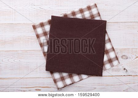 Napkin. Cloth napkin on white wooden background. Top view, mockup.