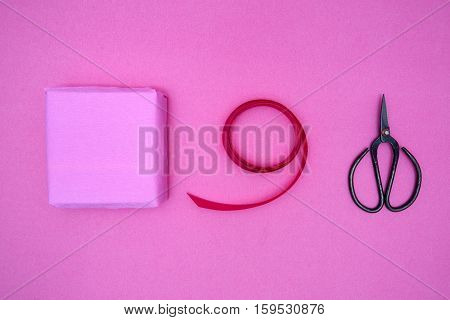 Box Gift, Ribbon And Antique Shears On Pink Background