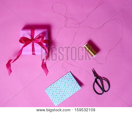 Box Gift, Gold Line And Antique Shears On Pink Background