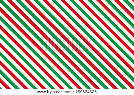 Red-green stripes on white background. Striped diagonal pattern Red-green diagonal lines background, Winter or Christmas theme
