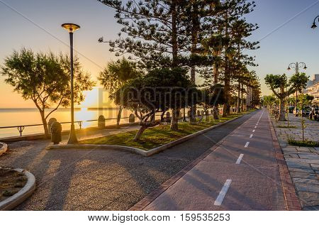 A picturesque promenade with palm trees in the soft morning light in Kos town, Kos island, Dodecanese, Greece.