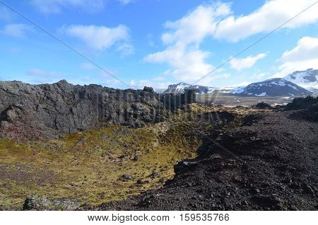 Glacial peaks as seen from a volcanic crater called Eldborg Crater in Iceland.