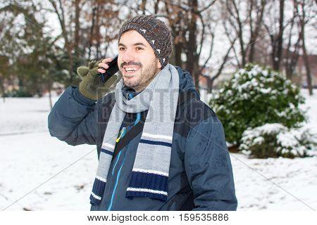 Bearded Man Using Cellphone In Winter