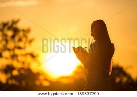 Women are memoirs on a note close at sunset.