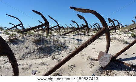 Anchor sculpture among the dunes at Barril beach, St Luzia, Portugal.