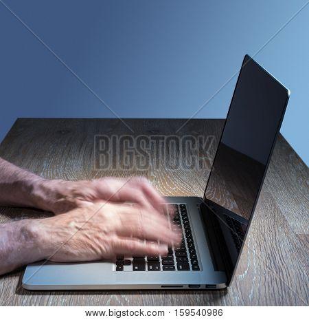 Senior Adult Man Touch Types On Laptop