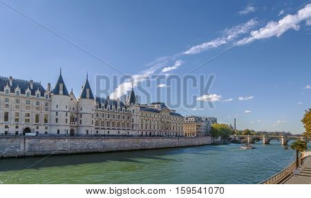 Waterfront view of the river Seine with Conciergerie Paris France
